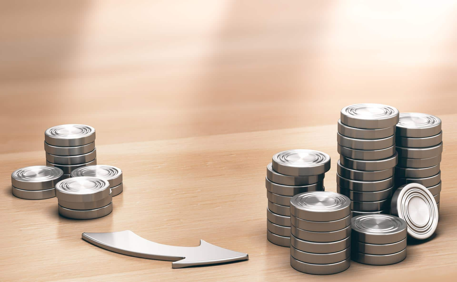 Two Piles of coins symbols on a wooden table and an arrow pointing the larger one. Financial profits concept. 3d illustration.